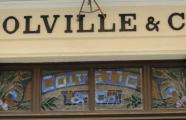 Casa Colville, details of plant decoration and sign of the company in stained glass